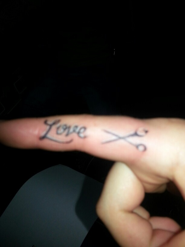 Scissor tattoo - cute. Not the placement though.