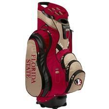 """Sun Mountain C130 Licensed Collegiate Cart Bags - Florida State Seminoles by Sun Mountain. $229.95. Integrated top handle with putter compartment; Putter compartment. Non-slip rubber feet; Strap tunnel; Insulated beverage pocket. 10"""" 14-way Top with individual full-length dividers; Single strap carry system. 3 lift assist handles; Ball Liner included and matching rainhood. 2 full length clothing pockets; 2 veour lined valuables pockets. Sun Mountain Collegiate ..."""