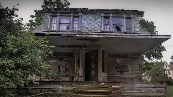View of an abandoned house in East Cleveland, Ohio. Looking at the windows it seems that this was once a beauty.....(Seph Lawless)