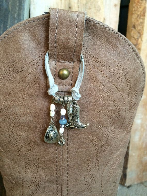 """Add some jingle to your step. Cute charms including cowboy hats, boots and spurs with a touch of sparkle. Sold individually. If you want a matching set, be sure to order two. Dangle measures 1.5"""" long. Leather band is 5.25"""" in length with magnetic clasp. Magnetic Clasp is attached with double jump ring for added security. Boot not included/shown for display purposes.  ------------------------------------------------------------------------------------------------  Looking for Bow Ties, N..."""