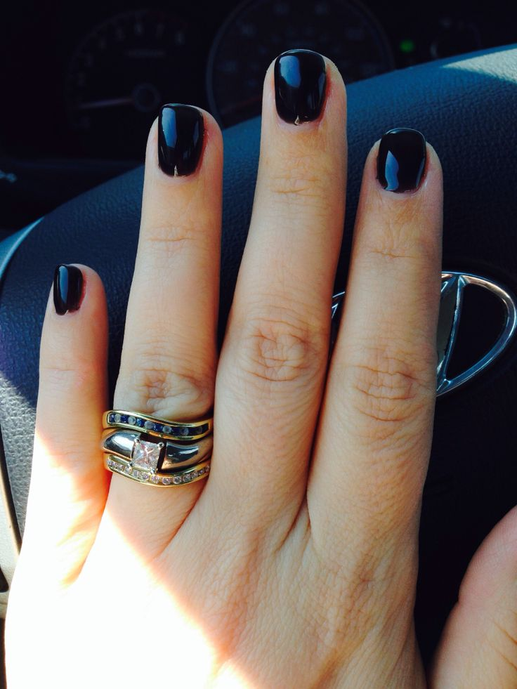 Black Gel Nails With One Silver Glitter Nail: Short, Black Gel Nails.