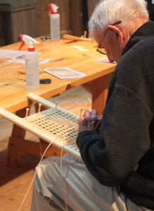 Hand-cane new canoe seats. Take a workshop at The Canadian Canoe Museum in Peterborough, Ontario.
