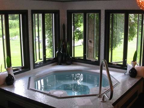 Mosaic tiles octagon hot tub with a stunning backyard for Soaking tub in master bedroom