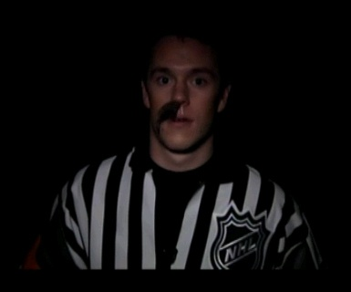 No this is not Jonathan Toews with a fake mustache, this is a legit NHL referee :P