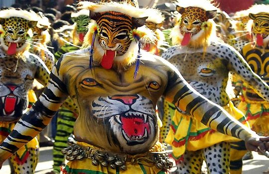 Onam is a Harvest Festival celebrated in the state of Kerala. While the festival in itself is colorful, with people reveling in the spirit of the harvest season, the highlight of the festival is Puli Kali. It is a traditional folk dance where people dressed as tigers and hunters in bright yellow costumes dance to drum beats.