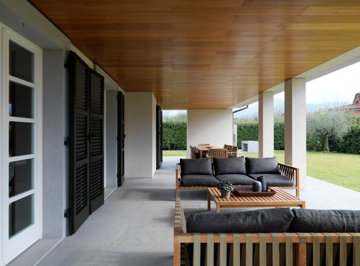 Super Contemporary Interior Designs for a Modern House: Cozy Soldati House Interior Outdoor Sitting With Wooden Sofa With Black Cushions Completed With Rectangular Wooden Coffee Table With Green ~ SFXit Design Interior Inspiration