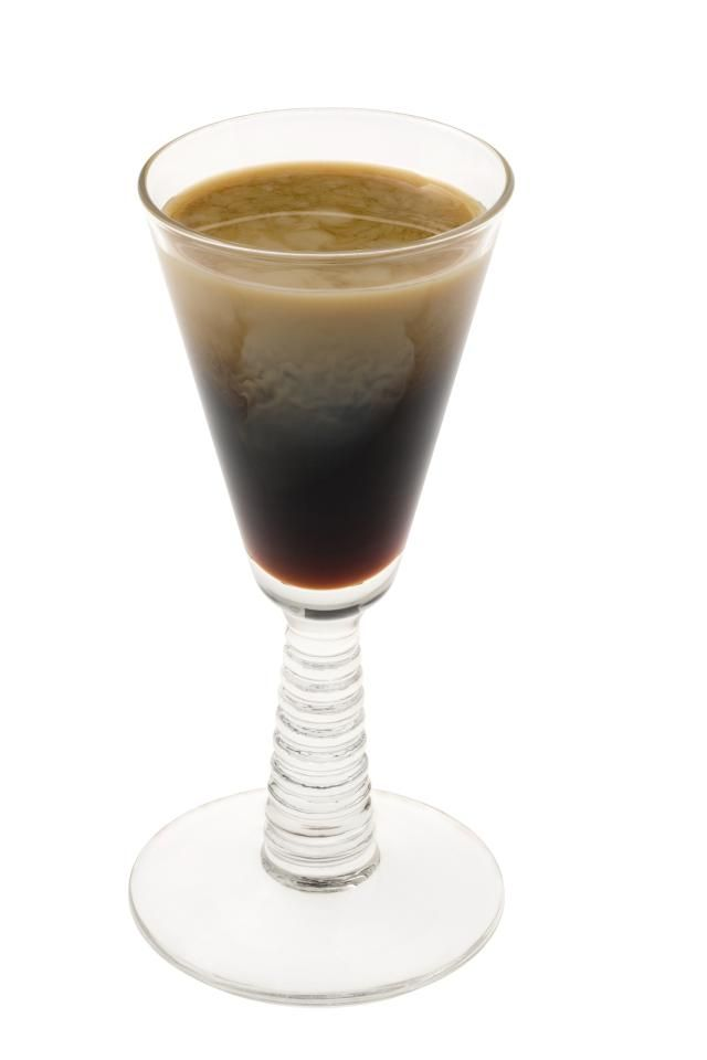 Shooter recipe for a Tootsie Roll, a party shot of Three Olives Chocolate vodka, amaretto and chocolate syrup designed to taste like the popular candy.