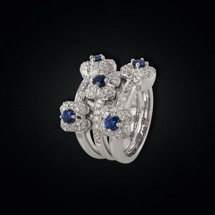 An Elegant 18K White Gold Sapphire & Diamond bouquet Ring