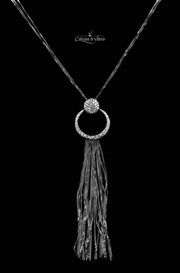 Elegant necklace in 18k white gold, center piece set with diamonds. Perfect for a night out on the town.