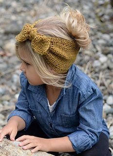 If this was red she'd look like a little Rosie the Riveter! So cute.  Crochet pattern on Ravelry