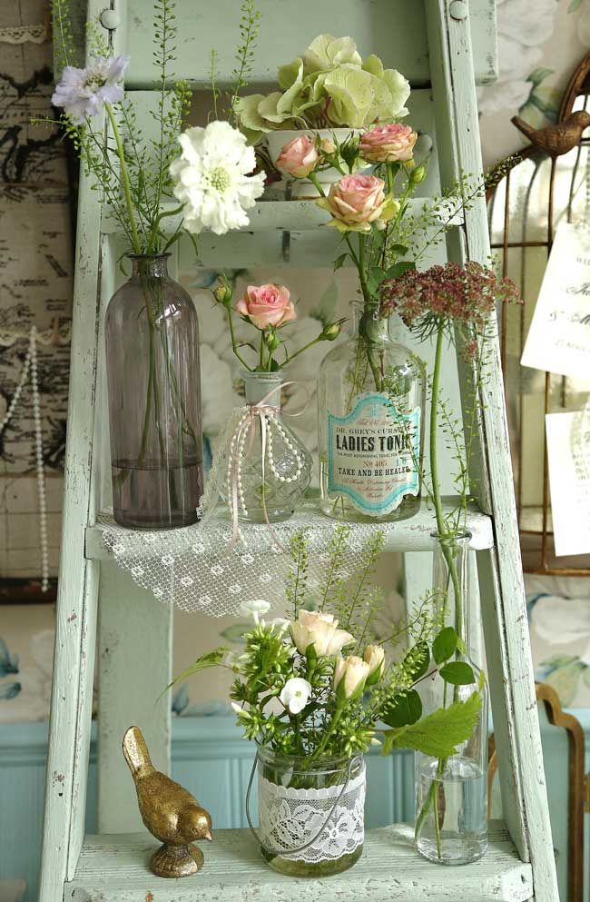 Charming cottage accent - vintage ladder with glass bottles, flowers, pearls, lace, bird figurine - nice shabby chic accent - I may do something like this on the back porch too - Retro wooden ladders from Bohemian Dreams