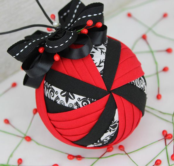 Windmill pattern by SugarPlum... a quilted (no-sew) fabric ornament. Tutorial available at www.theornamentgirl.com
