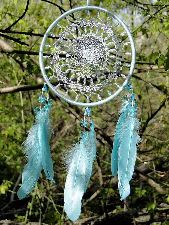 Sky Dance  ★ Diameter 8, Length 17 ★ One of a kind ★ Ready to ship  This dream catcher can be a beautiful and calming nursery decor addition. It is made in light pastel shades of blue and is decorated with soft feathers. The web is spangled with sparkling beads. It is woven with