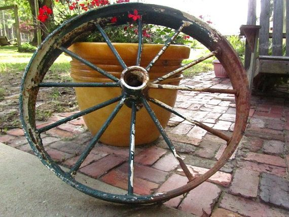 Antique wagon wheel, metal wheel, iron works, wall hanging, yard art, farm ,industrial