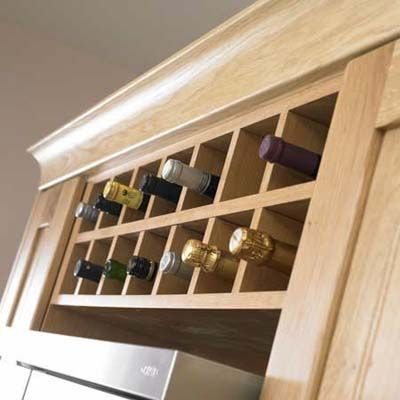 Give your cabinetry a customized look with wine bottle-sized cubby inserts you install yourself at great savings. This Sonoma Series Wine Rack is from Kitchen Source. | Photo: Andrew Hepinstall | thisoldhouse.com