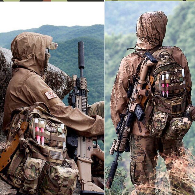 Two soldiers, in non-U.S. military camouflage, with SCARs in the mountains. jdm