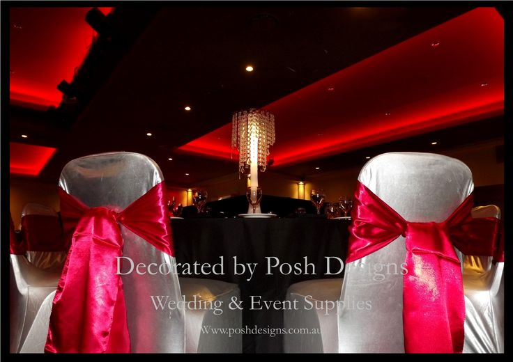 Red satin sashes, silver lycra chair covers, black tablecloths, chandelier table centres with LED lighting all for hire. Australia wide. Visit www.poshdesigns.com.au for more photos and info, or email lisa@poshdesigns.com.au for pricing packages