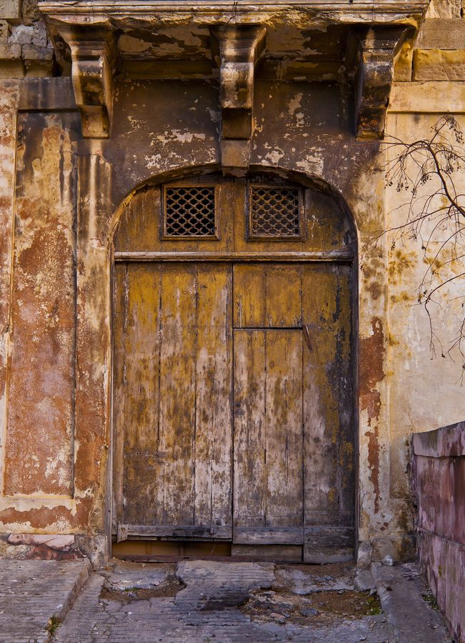 """bombed wall- like the range of textures and decay, the possibility of little squares of light at top of door and especially the architectural decoration above the door- perhaps the inspiration for the look for the """"lost"""" side of the walls"""