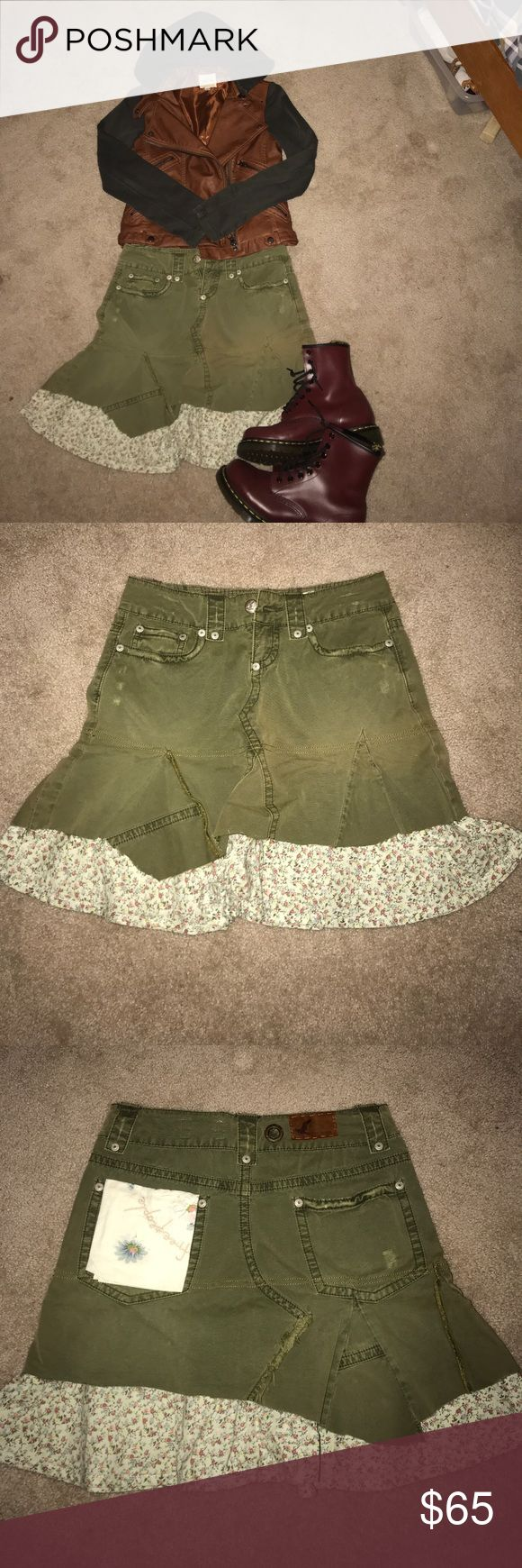 Free people skirt size 26 Very cool free people skirt.  Worn once!  Size 26 but runs small.  Very unique -as most free people clothing items are!- army drab green with floral shabby chic layer underneath the distressed asymmetrical green skirt.  Removable shabby chic handkerchief in the right pocket.  I wouldn't remove it.  It adds to the uniqueness of the skirt! I love this, I just never wore it as I'm not much of a skirt person. Free People Skirts Midi