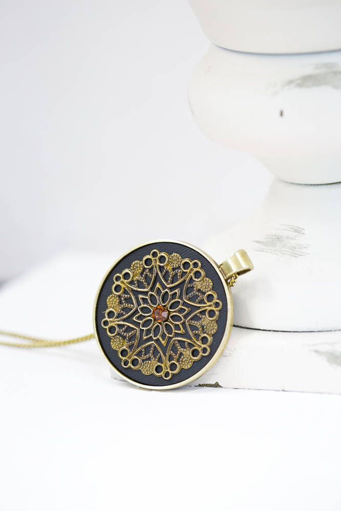 Black Leather Bronze Silver Pendant / Bronze Color Chain by BeautyfromashesUSA on Etsy https://www.etsy.com/listing/577509075/black-leather-bronze-silver-pendant