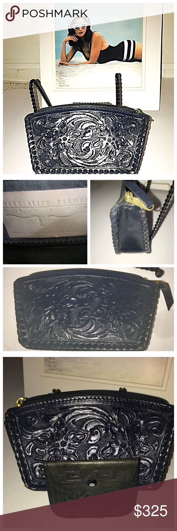 VINTAGE MARY ALICE PALMER NAVY CLUTCH, Very Rare You will love this vintage Mary Alice Palmer navy Tooled clutch in her famous design. This item is impossible to fine in this like new condition. i have added a coin purse which is in black . This is a great find Mary Alice Palmer Bags Clutches & Wristlets