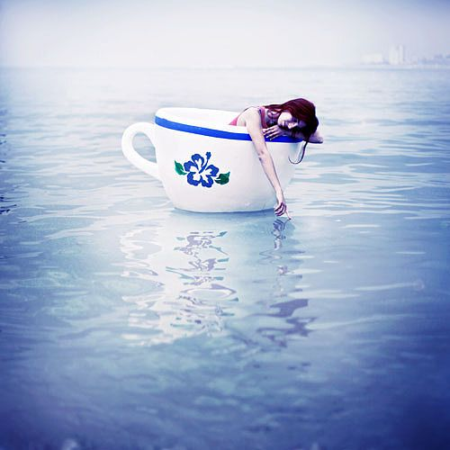 Photo Manipulations by Lara Zankoul- I love how everything is in shades of blue the girl floating in a childs tea cup on a sea of blue. Lost innocence or again with alice as she shrinks and crys that river of tears. Its a peacefull image but also sad.