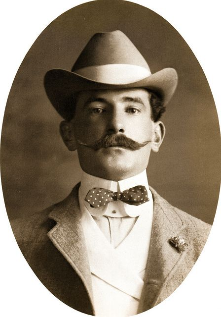Handsome Victorian Man with Mustache and tiny diamond point bow tie.