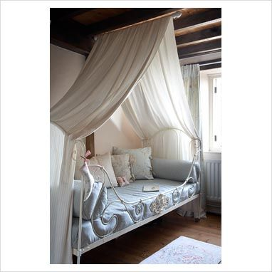 Diy canopy bed idea a curtain rod hung from the ceiling for Diy canopy bed curtains
