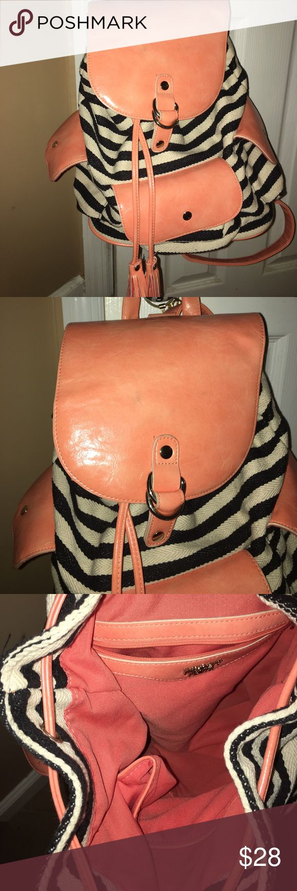 Striped nautical backpack from Nordstrom Purchased from Nordstrom. Brand is poverty flats. Never used . Canvas black and white stripes. Peach faux leather straps very roomy on inside and three snap pockets on outside great for spring summer poverty flats Bags Backpacks