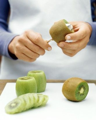 "Martha Stewart Living | ""Here's the easiest way to skin a kiwi: Trim both ends of the fruit; ease a tablespoon between the flesh and the peel. Turn the kiwi, pressing the back of the spoon against the peel as you go. The whole fruit should slide right out -- ready for slicing."""