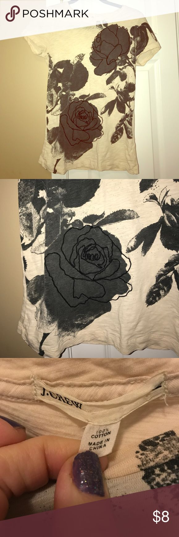 Short sleeved dressy floral tee size M Cream short sleeved tee with gray and black floral design on the front. Brand is J Crew and its in excellent condition. Some women's medium. J Crew Tops Tees - Short Sleeve