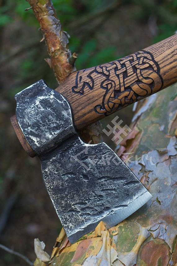 This is hand forged axe from 1095 steel with ash tree handle with scandinavian pattern and leather case. If you need to hike or chop down an old withered not big tree in the backyard this ax is for you. Small and moderately heavy it is the best axe for chopping.  Size of a head of an axe ~11*16,5 cm (~4 1/3*6 1/3 inches). The total length is 48 cm (18 3/4 inches). Weight - 0,75-0,85 kg. The axe is absolutely functional. Cutting edge is forged.  The axe will be custom made and b...