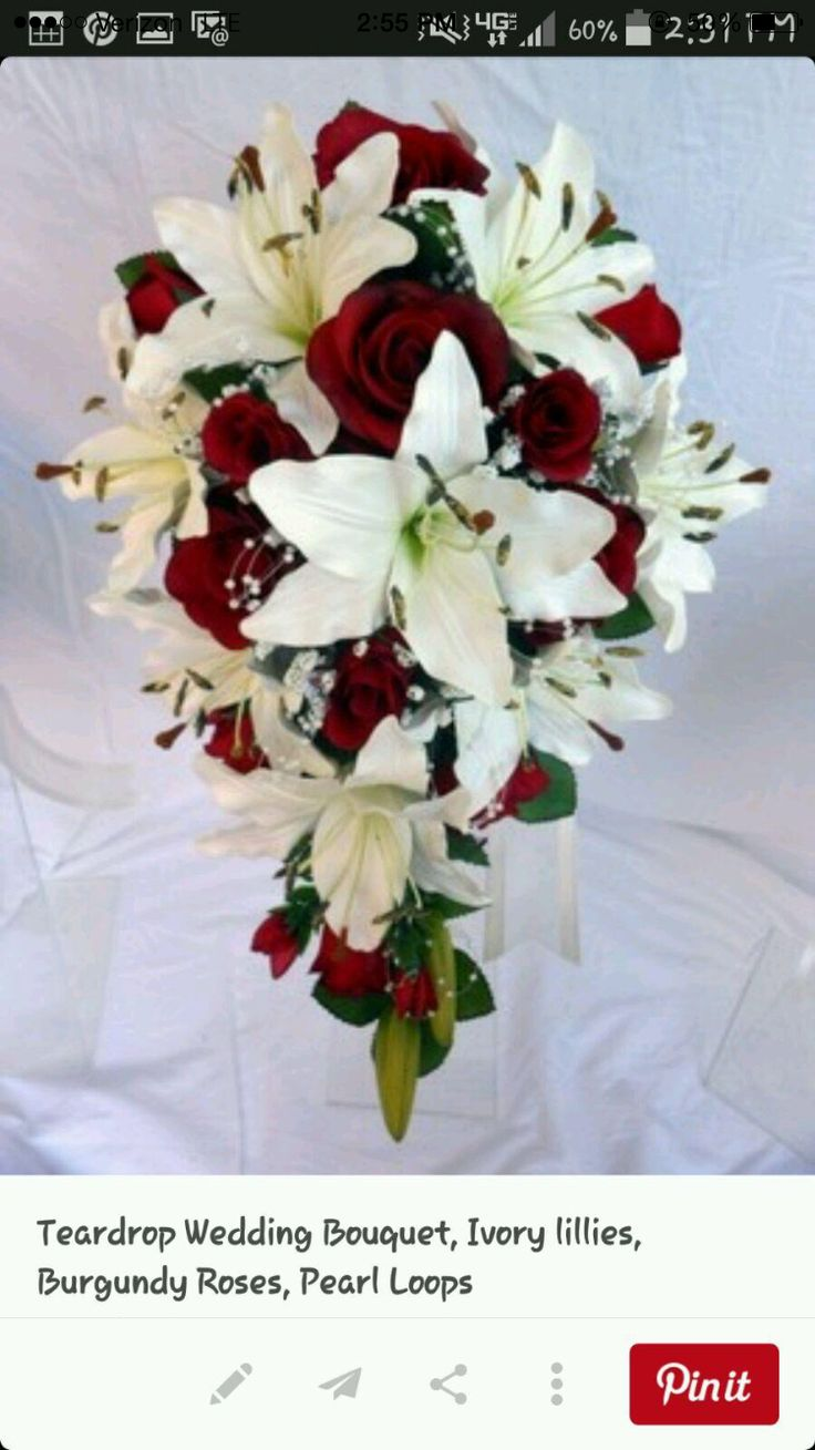 79 best images on pinterest floral arrangements flower cascade wedding bouquet ivory lillies burgundy roses pearl loops beautiful for a winter wedding izmirmasajfo