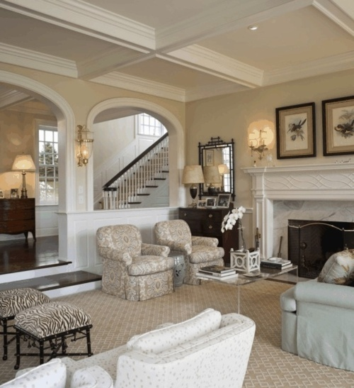 Terrific architectural detailing like coffered ceilings and half arches in this sunken living room by Archer & Buchanan Architects outside Philadelphia. Overall neutral scheme is made interesting through combination of textures and patterns - wonderful geometric Stark carpet with touches of Chinoiserie and animal print.