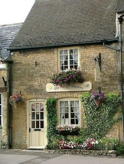 Cottage with window boxes.