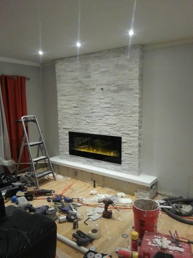See how to transform the blank wall into favorite part of the house-add stacked stone fireplace