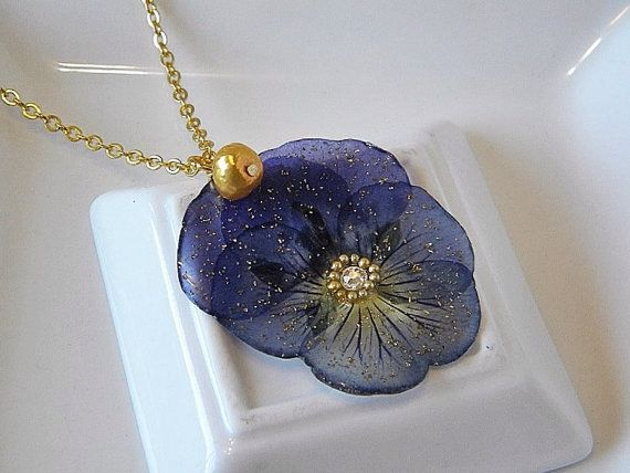 Pressed flower pendant composed of purple pansy, swarovski crystals and gold glass glitter sealed in resin. Gold plated 18 chain with gold freshwater