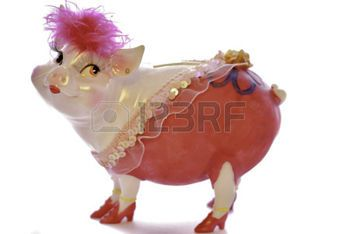 painted piggy bank: piggy bank pink pig dressed as a woman beautifully rich painted bright make-up wearing boots, fastened pink fringe  Stock Photo