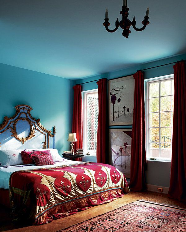 Dramatic sky blue and red bedroom. The home of designer Olatz Schnabel, photographed by Jason Schmidt.