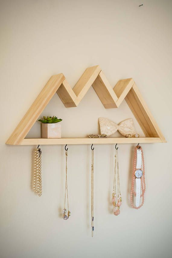 These mountain shelves are handmade from pine in New Brunswick, Canada. There are five small hooks which make them the perfect jewelry rack or key rack, and are easy to hang with two small nails. These are made to order so expect your order to be shipped out in 5-10 business days.