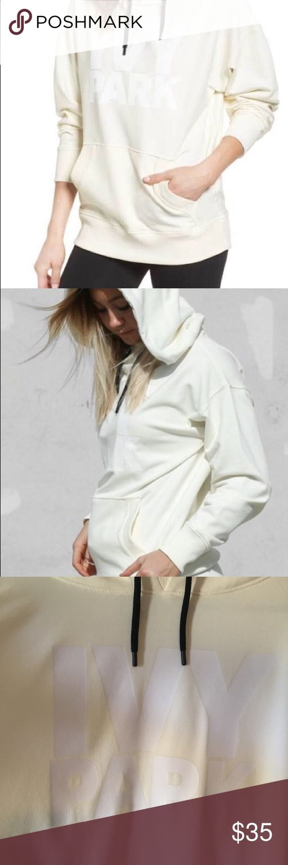 IVY PARK Logo Hoodie Cream Beyoncé streetwear style meets a lounge essential on this oversized cotton-blend sweatshirt with an exaggerated hood, ribbed- inset funnel neck and a cool logo graphic. This cream hoodie can be wore oversized. Will fit someone who wears a med to large, but it's a true large in size. Hoodie has never been worn or washed! IVY PARK Tops Sweatshirts & Hoodies