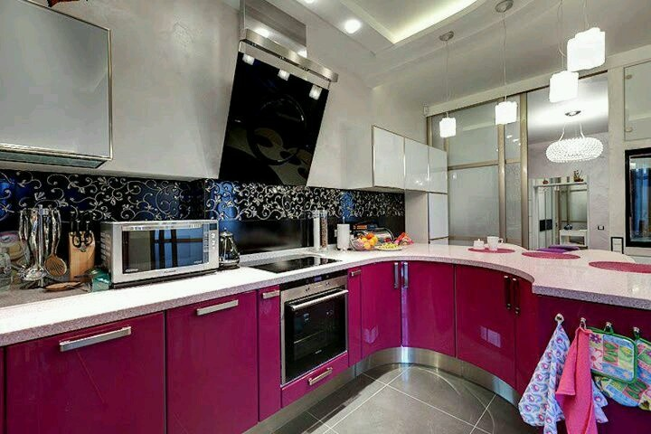 Pink, black, and white kitchen with stainless steel accents