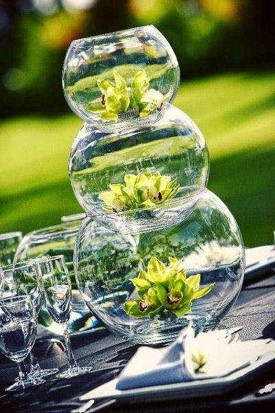 Fish bowls and flower tower--another creative centerpiece. (I can even envision this as the base of a decorative end table, using slightly larger glass bowls, topped with a round piece of glass.)