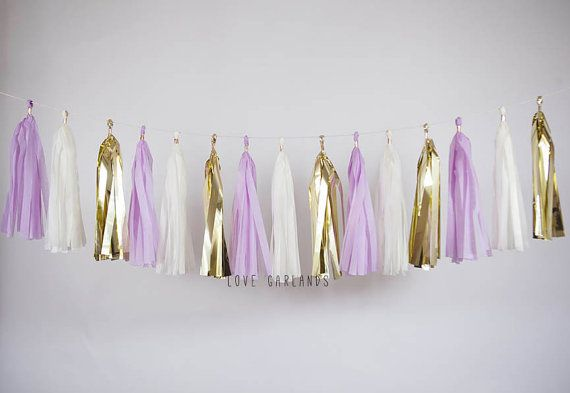 Lets celebrate with this Ivory, Gold, Lilac tassel garland!  This tassel garland is great for: weddings bridal showers birthday parties baby showers gender reveal home decor nursery or childrens room dorm decor photo backdrop and much more!  This tassel garland is handmade with love using tissue paper. The garland comes ready to hang at 8 feet long when tassels are spread apart evenly. Tassels can be easily moved along the twine to provide a sparser or fuller look depending on your taste…
