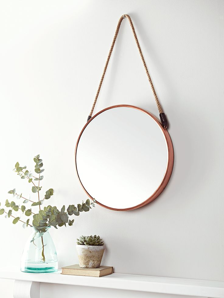 Inspired by our bestselling Cruise Mirror, this larger version with a warm copper frame will add a feeling of space and light to whichever room you place it in. With a subtle nod to nautical style, it has a braided rope to hang from the wall.
