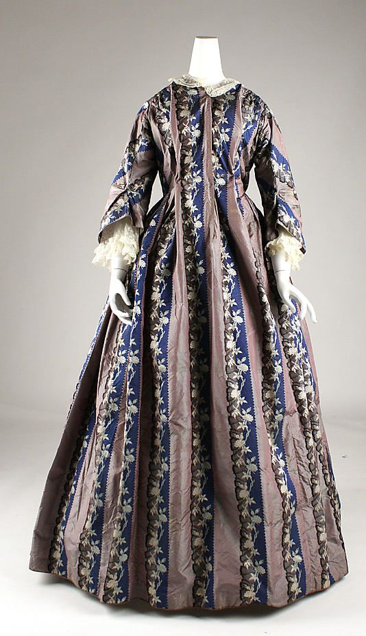 This is a dressing gown!  Really poofy. Blue floral and dusty lavender stripes.  Silk.  c. 1850.