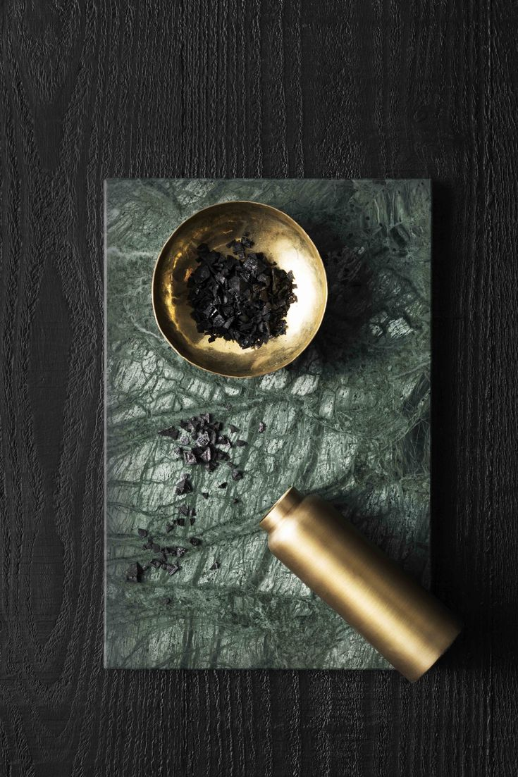 zakkia SS 2015 | handmade green marble serving board | polished brass bottle and bowl