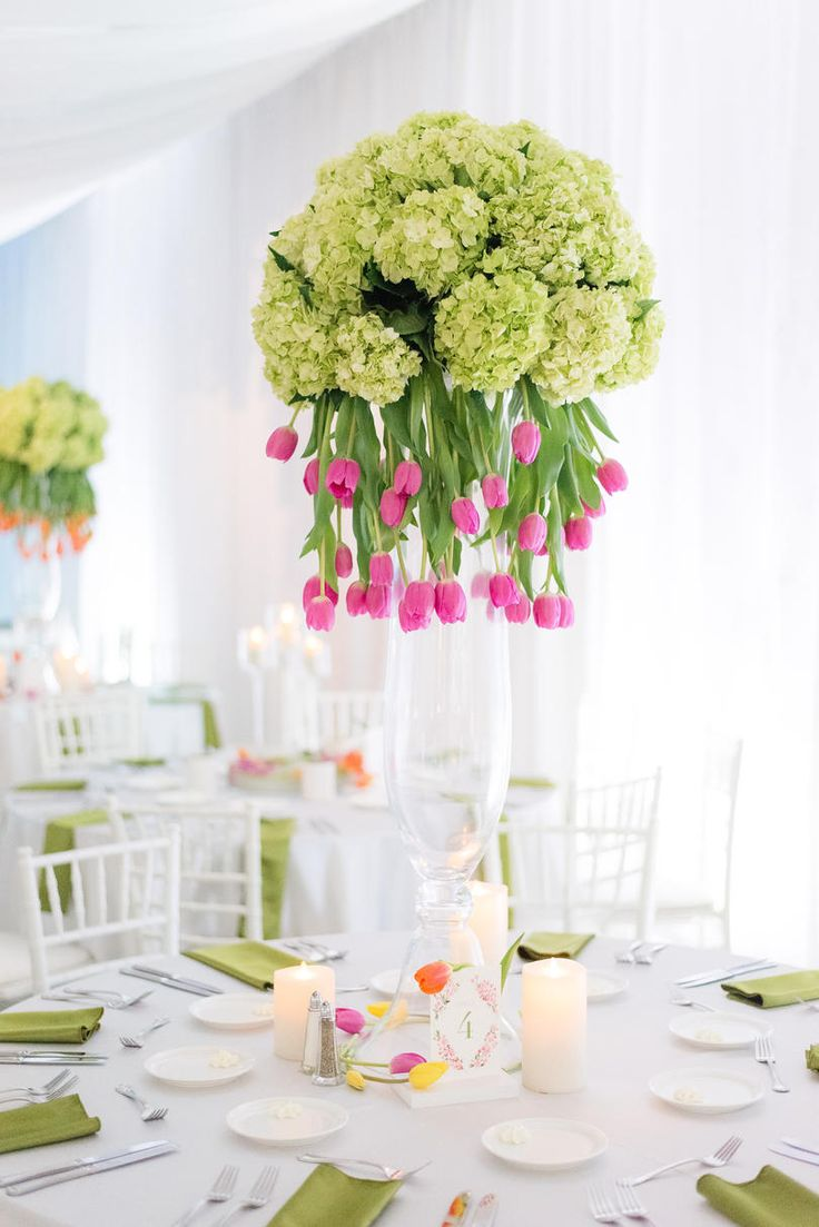 Florals Dazzle the Dinner Table | Stunning tulips and unexpected color stole the show at this Birmingham wedding bash. Ashley walked into wedding planning with a wish for something different, and man oh man did she deliver. Taking inspiration from art deco destinations, she used bubblegum pink and vivid greens in a way only an artist's eye could have envisioned at her reception. The Birmingham Museum of Art was the perfect canvas for Carlos and Ashley's striking, stem-filled celebration.