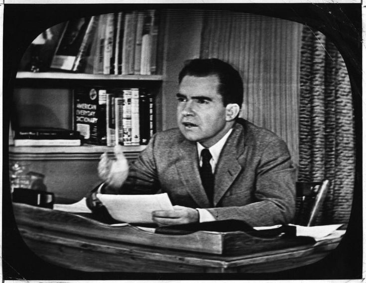 "Heretic, Rebel, a Thing to Flout: ""Our Little Dog Checkers""—Nixon's Great Shield, Nixon would address the camera directly with no questions or host.  There would be no audience in the El Capitan Theatre where before a plain curtain a set of inexpensive GI furniture sat on an otherwise undecorated stage.  The press was sequestered in an off-stage room and made to watch, like America, on television sets.  A team of stenographers were on hand to provide accurate records of the speech."