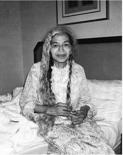 A rare photo of Rosa Parks taking her hair down before turning in for the night.